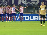 Atletico Madrid's team celebrates a goal by midfielder Raul Garcia against Austria Wien during the UEFA Champions League Group G football match Austria Wien vs Atletico de Madrid in Vienna, Austria on October 22, 2013