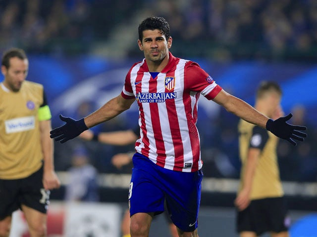 Atletico Madrid's Brazilian forward Diego da Silva Costa celebrates a goal during the UEFA Champions League Group G football match Austria Wien vs Atletico de Madrid in Vienna, Austria on October 22, 2013