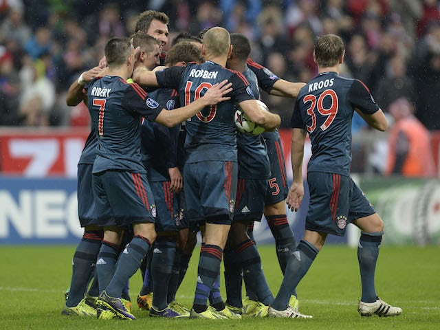 Several Bayern Munich players celebrate after the fourth goal during the UEFA Champions League group D match against Plzen on October 23, 2013