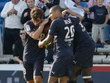 Bordeaux's players celebrates after scoring a goal during the French L1 football match between Bordeaux and Montpellier on October 27, 2013