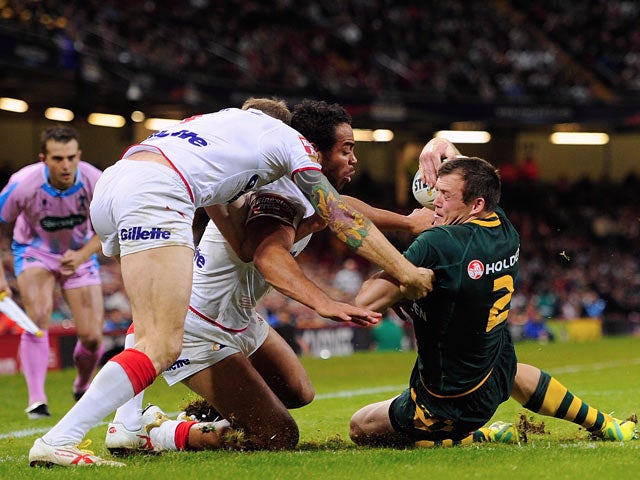 Australia's Brett Morris beat England's defence to scores a try during their World Cup Group A match on October 26, 2013