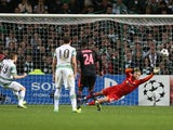 Ajax's goalkeeper Kenneth Vermeer is beaten by the penalty kick taken by Celtic's Scottish midfielder James Forrest during the UEFA Champions League Group H football match between Celtic and Ajax at Celtic Park in Glasgow, Scotland, on October 22, 2013