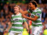 James Forrest of Celtic is congratulated by teammate Virgil van Dijk of Celtic after scoring the opening goal from the penalty spot during the UEFA Champions League Group H match between Celtic and Ajax at Celtic Park Stadium on October 22, 2013