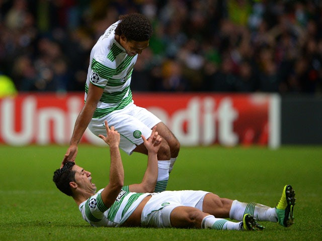 Biram Kayal of Celtic is congratulated by teammate Virgil van Dijk of Celtic after scoring his team's second goal during the UEFA Champions League Group H match between Celtic and Ajax at Celtic Park Stadium on October 22, 2013