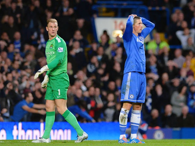 Joe Hart of Manchester City looks on as Fernando Torres of Chelsea reacts after missing a chance at goal during the Barclays Premier League match between Chelsea and Manchester City at Stamford Bridge on October 27, 2013