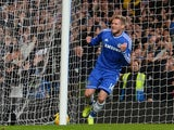 Chelsea's German striker Andre Schurrle celebrates scoring the opening goal of the English Premier League football match between Chelsea and Manchester City at Stamford Bridge in west London on October 27, 2013