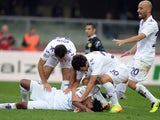 Juan Guillermo Cuadrado of ACF Fiorentina (C) is congratulated by team-mates after scoring their team's first goal to equalise during the Serie A match between AC Chievo Verona and ACF Fiorentina at Stadio Marc'Antonio Bentegodi on October 27, 2013