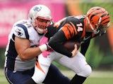 Chris Jones #94 of the New England Patriots sacks quarterback Andy Dalton #14 of the Cincinnati Bengals in the second quarter at Paul Brown Stadium on October 6, 2013