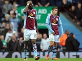 Christian Benteke of Aston Villa looks dejected following Everton's second goal during the Barclays Premier League match on October 26, 2013