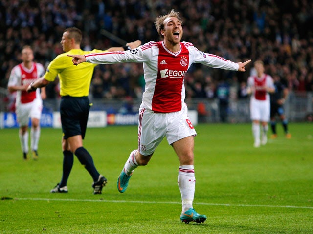 Christian Eriksen (#8) of Ajax celebrates after he shoots and scores his teams third goal of the game during the Group D UEFA Champions League match between AFC Ajax and Manchester City FC at Amsterdam ArenA on October 24, 2012