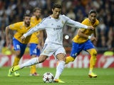 Real Madrid's Portuguese forward Cristiano Ronaldo scores a penalty during the UEFA Champions League Group B football match against Juventus on October 23, 2013