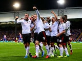 Fulham's Dimitar Berbatov celebrates with team mates after scoring his team's third goal against Crystal Palace on October 21, 2013