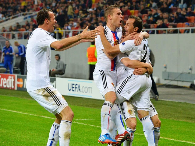 Marcelo Diaz of FC Basel celebrates scoring with his teammates during the UEFA Champions League Group E football match FC Steaua Bucuresti vs FC Basel 1893 in Bucharest, Romania on October 22, 2013