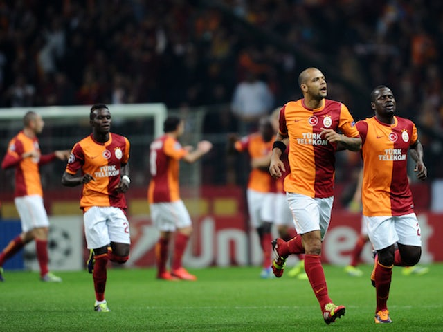 Galatasaray's Brazilian midfielder Felipe Melo celebrates scoring a goal during the UEFA Champions League Group B football match between Galatasaray and FC Copenhagen on October 23, 2013
