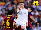 Gareth Bale of Real Madrid CF duels for the ball with Sergio Busquets of FC Barcelona during the La Liga match on October 26, 2013