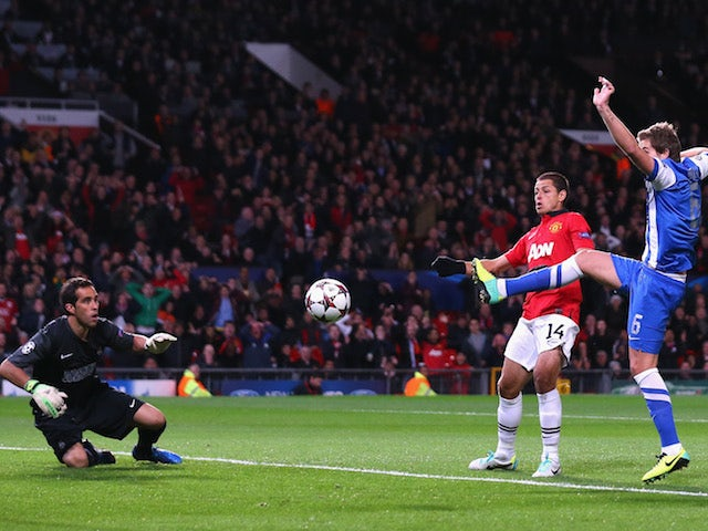 Inigo Martinez of Real Sociedad scores an own goal during the UEFA Champions League Group A match between Manchester United and Real Sociedad on October 23, 2013