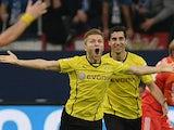 Dortmund's Jakub Blaszczykowski celebrates after scoring his team's third goal against Schalke on October 26, 2013