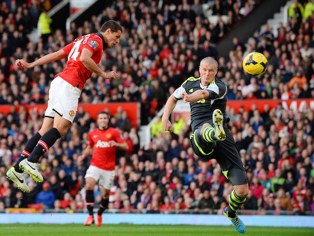 Manchester United's Mexican forward Javier Hernandez scores the third goal during the English Premier League football match against Stoke City on October 26, 2013
