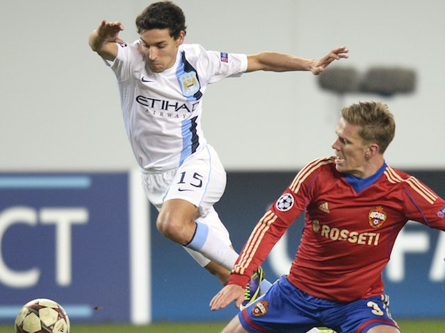 CSKA Mocow's midfielder Pontus Wernbloom vies with Manchester City's midfielder Jesus Navas during their UEFA Champions League group D football match in Moscow on October 23, 2013
