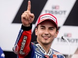 Jorge Lorenzo of Spain and Yamaha Factory Racing celebrates victory under the podium at the end of the MotoGP race ahead of the Australian MotoGP on October 20, 2013