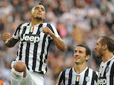 Arturo Vidal of Juventus celebrates after scoring the opening goal during the Serie A match between Juventus and Genoa CFC at Juventus Arena on October 27, 2013