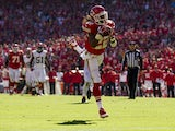 Running back Jamaal Charles #25 of the Kansas City Chiefs makes a leaping catch into the end zone for a touchdown during the game against the Cleveland Browns at Arrowhead Stadium on October 27, 2013