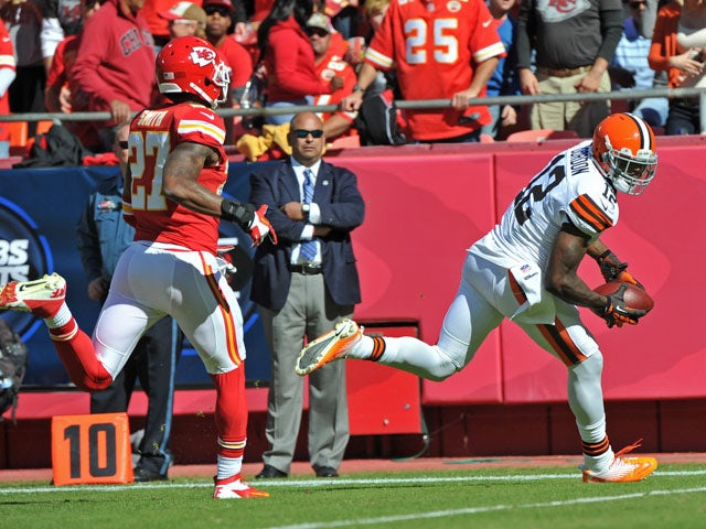 Wide receiver Josh Gordon #12 of the Cleveland Browns catches a 39-yard touchdown against defensive back Sean Smith #27 of the Kansas City Chiefs during the first half on October 27, 2013