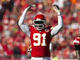 Outside linebacker Tamba Hali #91 of the Kansas City Chiefs attempts to pumps up the crowd on fourth down during the game against the Cleveland Browns at Arrowhead Stadium on October 27, 2013