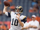 Quarterback Kellen Clemens #10 of the St. Louis Rams warms up against the Denver Broncos at Sports Authority Field at Mile High on August 24, 2013