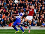 Burnley's Kieran Trippier and QPR's Junior Hoilett battle for the ball during their Championship match on October 26, 2013