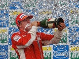 Kimi Raikkonen of Finland and Ferrari celebrates on the podium after winning the race and the F1 World Championship at the Brazilian Grand Prix on October 21, 2007