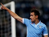 Miroslav Klose of SS Lazio celebrates after scoring the opening goal during the Serie A match between SS Lazio and Cagliari Calcio at Stadio Olimpico on October 27, 2013