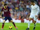 Barcelona's Argentinian forward Lionel Messi vies with Real Madrid's Portuguese forward Cristiano Ronaldo during the Spanish league Clasico football match on October 26, 2013