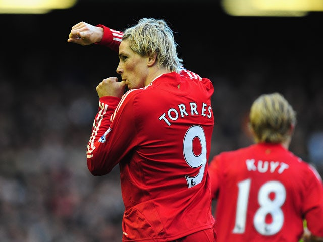 Fernando Torres of Liverpool celebrates scoring the opening goal during the Barclays Premier League match between Liverpool and Manchester United at Anfield on October 25, 2009