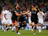Andy Goode of London Wasps is congratulated by Captain, Chris Bell after converting a drop goal during the Aviva Premiership match between London Wasps and Leicester Tigers at Adams Park on October 27, 2013