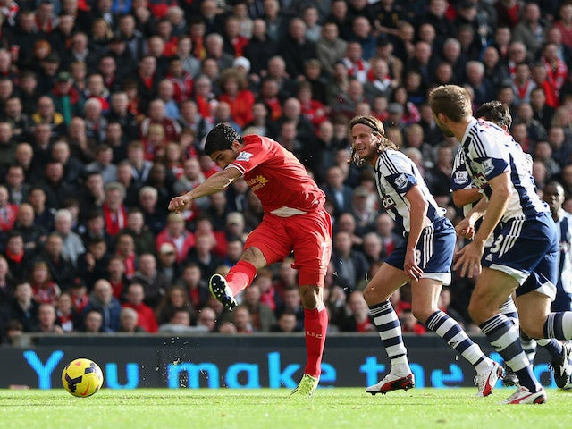 Luis Suarez of Liverpool scores the opening goal during the Barclays Premier League match between Liverpool and West Bromwich Albion at Anfield on October 26, 2013