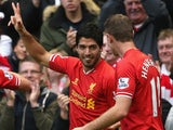 Luis Suarez of Liverpool celebrates completing his hat-trick during the Barclays Premier League match against West Brom on October 26, 2013