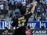 Reims' Mads Albaek celebrates after scoring his team's second goal against Marseille on October 26, 2013