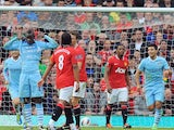 Mario Balotelli celebrates scoring in the Manchester derby at Old Trafford on October 23, 2011.
