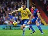 Arsenal's Aaron Ramsey and Crystal Palace's Mile Jedinak in action during their Premier League match on October 26, 2013