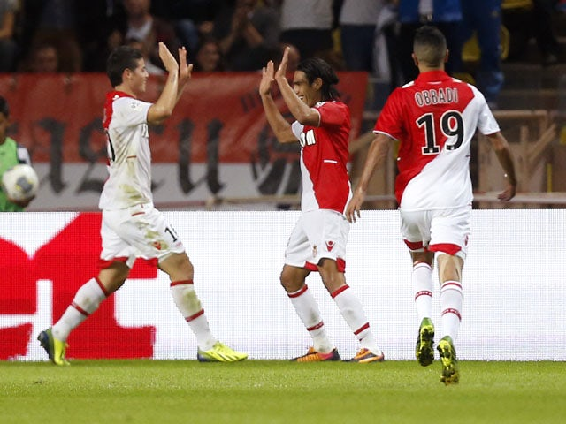 Monaco's Colombian forward Radamel Falcao celebrates with teammates after scoring during the French L1 football match Monaco (ASM) vs Lyon (OL) on October 27, 2013