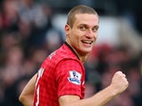 Nemanja Vidic of Manchester United celebrates scoring the second goal during the Barclays Premier League match against Liverpool on January 13, 2013