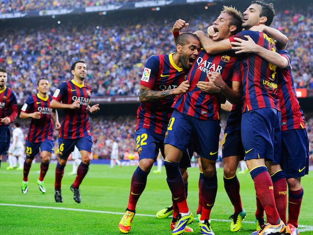 Neymar celebrates with his team-mates after scoring the opening goal during the La Liga match between FC Barcelona and Real Madrid CF at Camp Nou on October 26, 2013
