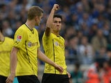 Dortmund's Nuri Sahin celebrates after scoring his team's second goal against Schalke on October 26, 2013