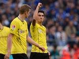Dortmund's Nuri Sahin celebrates after scoring his team's second goal against Schalke on October 26, 2013