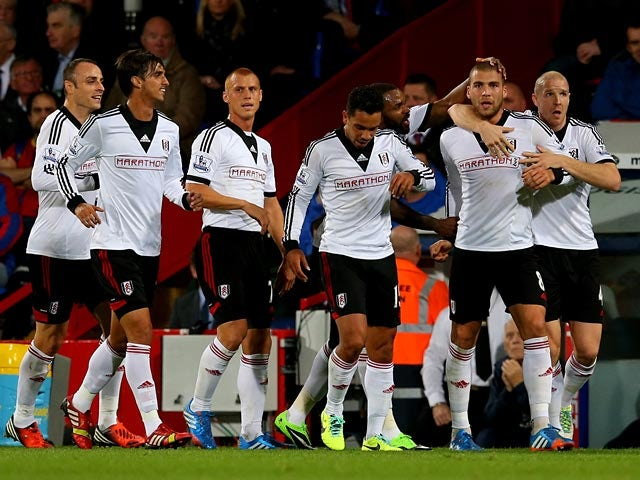 Fulham's Pajtim Kasami is congratulated by team mates after scoring the equaliser against Crystal Palace on October 21, 2013