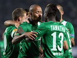 Maccabi Haifa's South African forward Dino Ndlovu celebrates with teammates after scoring a goal during the UEFA Europa League group L football match PAOK Thessaloniki and Maccabi Haifa in Toumpa Stadium in Thessaloniki on October 24, 2013