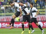 Marco Parolo of Parma FC celebrates with his team-mates Alessandro Lucarelli after scoring the opening goal during the Serie A match between Parma FC and AC Milan at Stadio Ennio Tardini on October 27, 2013