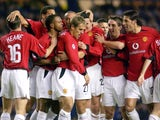 Manchester United players celebrate Phil Neville's goal against Rangers on October 22, 2003.
