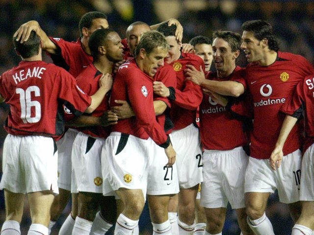 Manchester United players celebrate Phil Neville's goal against Rangers on October 22, 2003.